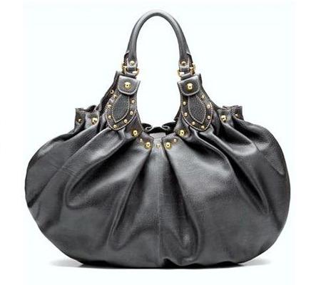 Модные и актуальные сумки с заклепками на любой вкус. фото 2.